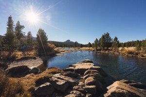 USA, California, Yosemite National Park, Tuolumne meadows against the sun - KKAF03019