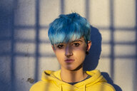 Portrait of young woman with dyed blue hair and nose piercing - ERRF00116