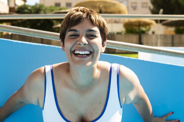 Portrait of laughing young woman in swimwear - ERRF00124