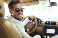 Successful young businessman driving in his car - JSRF00100