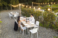 Italy, Tuscany, Siena, young couple having dinner in a vineyard - FBAF00184