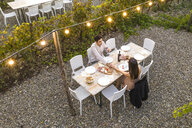 Italy, Tuscany, Siena, young couple having a romantic dinner in a vineyard - FBAF00187