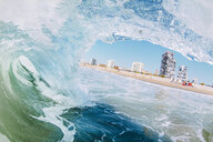 Buildings seen through wave in sea - CAVF56032