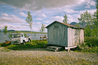 A built structure and van on a field - INGF07786