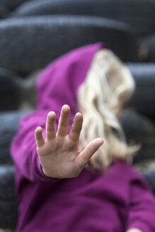 Girl raising her hand, close-up - JFEF00934