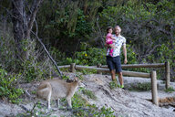 Australia, Queensland, Mackay, Cape Hillsborough National Park, father and daughter with a kangaroo - GEMF02571