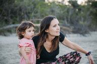 Australia, Queensland, Mackay, Cape Hillsborough National Park, mother and daughter exploring the beach - GEMF02580