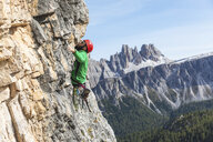 Italy, Cortina d'Ampezzo, man climbing in the Dolomites mountains - WPEF01140