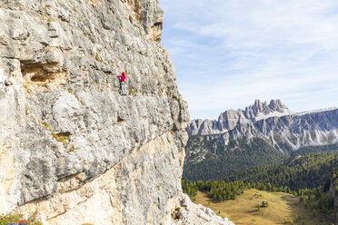 Italy, Cortina d'Ampezzo, woman climbing in the Dolomites mountains - WPEF01146