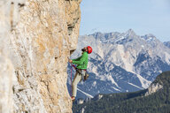 Italy, Cortina d'Ampezzo, man climbing in the Dolomites mountains - WPEF01149
