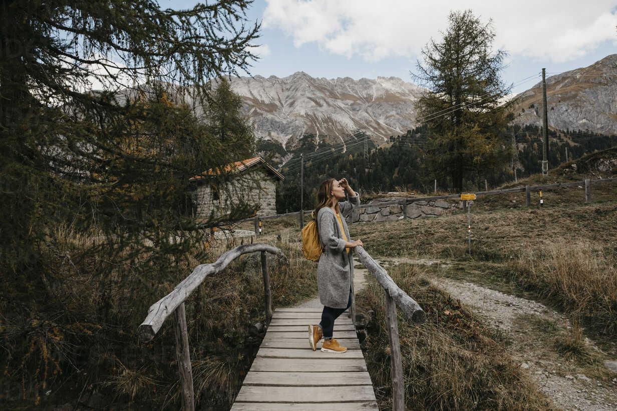 Switzerland, Engadin, woman on a hiking trip on a wooden bridge - LHPF00156 - letizia haessig photography/Westend61