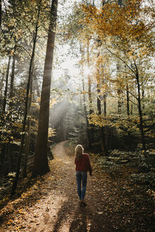 Germany, Black Forest, Sitzenkirch, woman walking in autumnal forest - LHPF00158