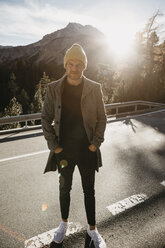 Man travelling through Switzerland, standing on road - LHPF00180
