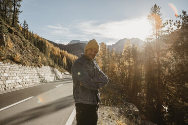 Man travelling through Switzerland, standing on road - LHPF00183