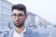Portrait of bearded young businessman wearing glasses - TCF05995