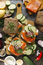 Close-up of salmon and vegetables sandwich on cutting board - CAVF56446