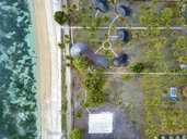 Indonesia, West Sumbawa, Aerial view of Kertasari, beach and huts from above - KNTF02374