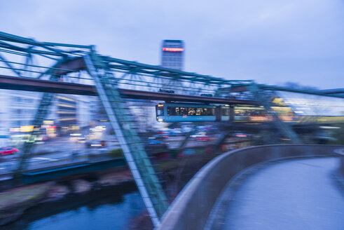 Germany, Wuppertal, overhead railway at dusk - SKAF00056