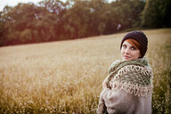 Portrait of a young woman embracing nature in a field - INGF07845