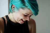 Close-up shot of a young woman with blue hair - INGF07920