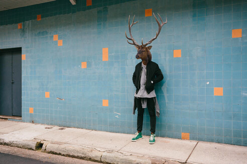 Full length of man with deer face standing outdoors. - INGF07962