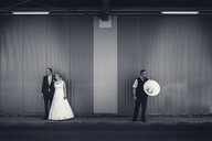 Black and white shot of a bride and groom at the train station - INGF08052