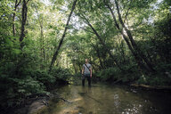Young man fishing in a forest - VPIF01161
