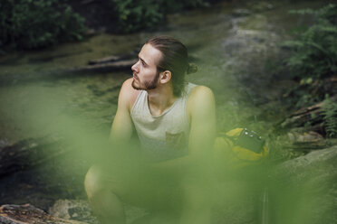 Young hiker having a break in the forest - VPIF01173