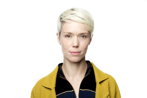 Portrait of woman with short blond dyed hair in front of white background - FLLF00044