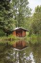 Germany, Bavaria, Oberallgaeu, Moorweiher near Oberstdorf, wooden hut - WIF03675