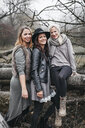 Group picture of three friends in autumnal nature - HMEF00120
