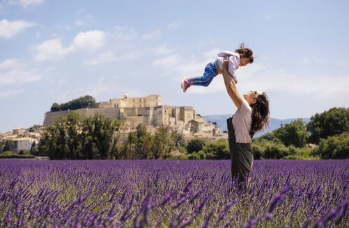 France, Grignan, mother and little daughter having fun together in lavender field - GEMF02593
