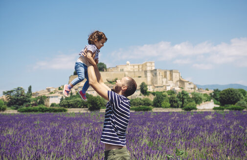 France, Grignan, father and little daughter having fun together in lavender field - GEMF02614