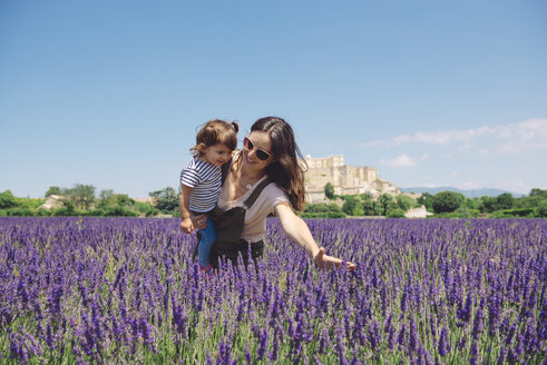 France, Grignan, mother and little daughter having fun together in lavender field - GEMF02620