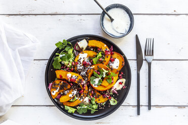 Autumnal salad with fried pumpkin, lentils, radicchio, pomegranate seeds, leaf salad and parsley with dressing - SARF03994