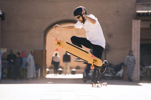 Man skateboarding during sunny day - CAVF56759