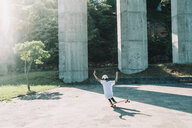 High angle view of man skateboarding at park during sunny day - CAVF57230