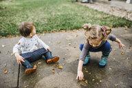 Siblings playing on driveway - CAVF57462