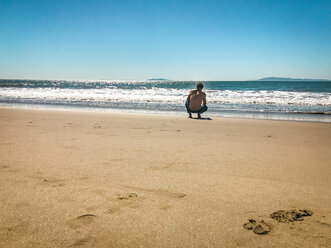 Man taking a break at Ventura Beach, California, USA - SEEF00055