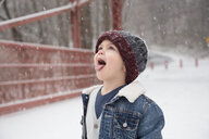 Little Boy Trying To Catch Snowflakes On Tongue - TGBF01624