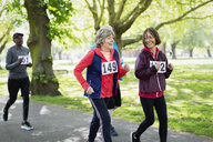 Active senior women friends power walking sports race in park - CAIF22317