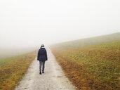 Woman walking in fog - WWF04499
