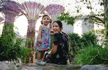 Singapore, Gardens by the Bay, mother and daughter enjoying Supertree Grove at sunset - GEM02642