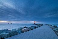 A lighthouse at sea under a dark sky - INGF08300