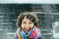 Portrait of a smiling young woman in the snow - INGF08309