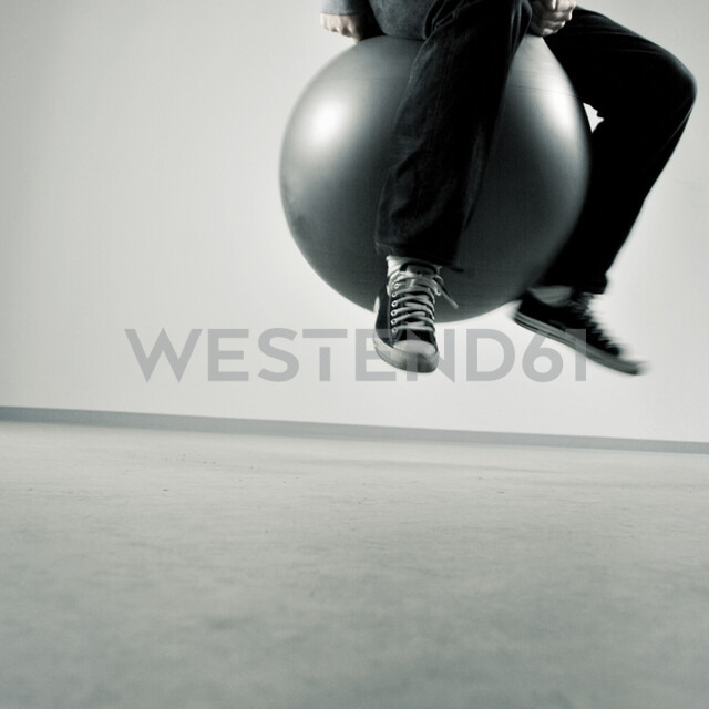 Action shot of a man on a bouncy ball - INGF08360