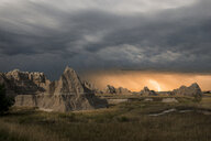 Majestic view of rock formations at Badlands National Park against thunderstorm and lightning - CAVF57506