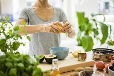 Woman preparing healthy food in her kitchen - MOEF01800