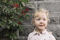 Cute girl looking away against wall - CAVF57933