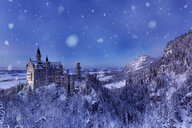 Germany, Hohenschwangau, view to Neuschwanstein castle at snowfall and blue hour - FC01668